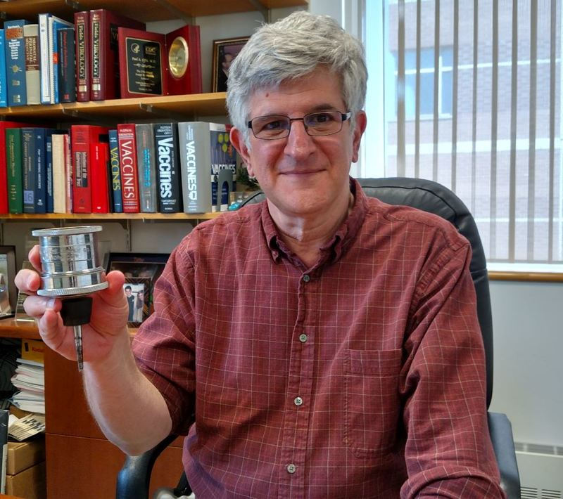 Paul Offit holding the seitz filter.JPG