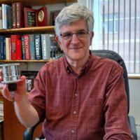 Paul Offit holding the seitz filter.JPG